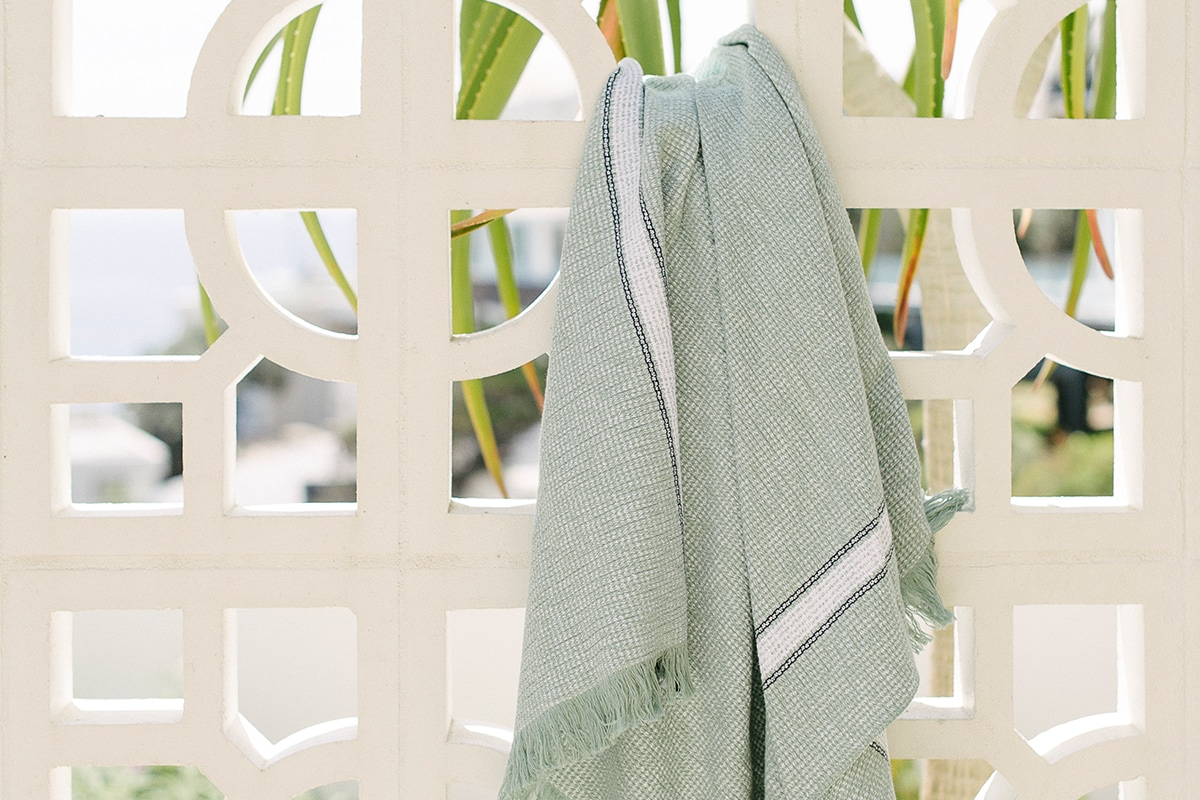 Mungo Summer Towel in Mint Colourway. Woven from pure cotton at the Mungo Mill