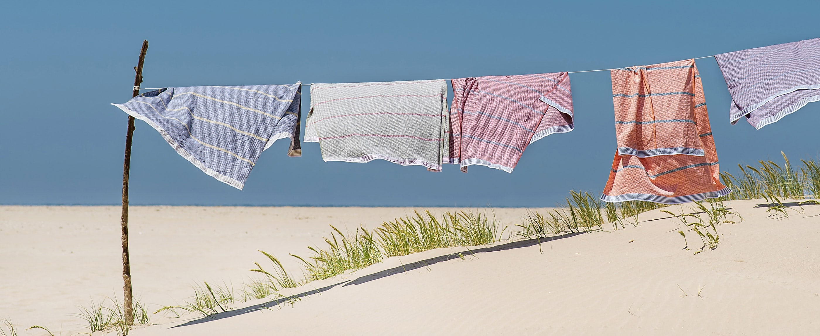 Mungo Flat Weave Towels hanging in the breeze. Made from natural fibres in South Africa