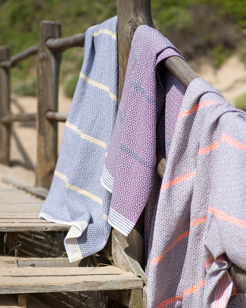 Mungo Itawuli at the beach. A lightweight, soft and absorbent flat weave towel made in South Africa