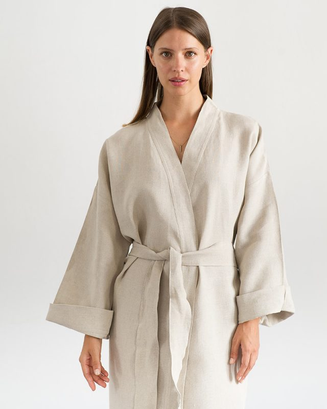 Woman wearing an all natural fibre Mungo Kamma Linen Gown in Natural, one of the items in our apparel range.