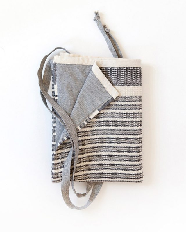 Folded Mungo Man Cloth Apron with black and white stripes