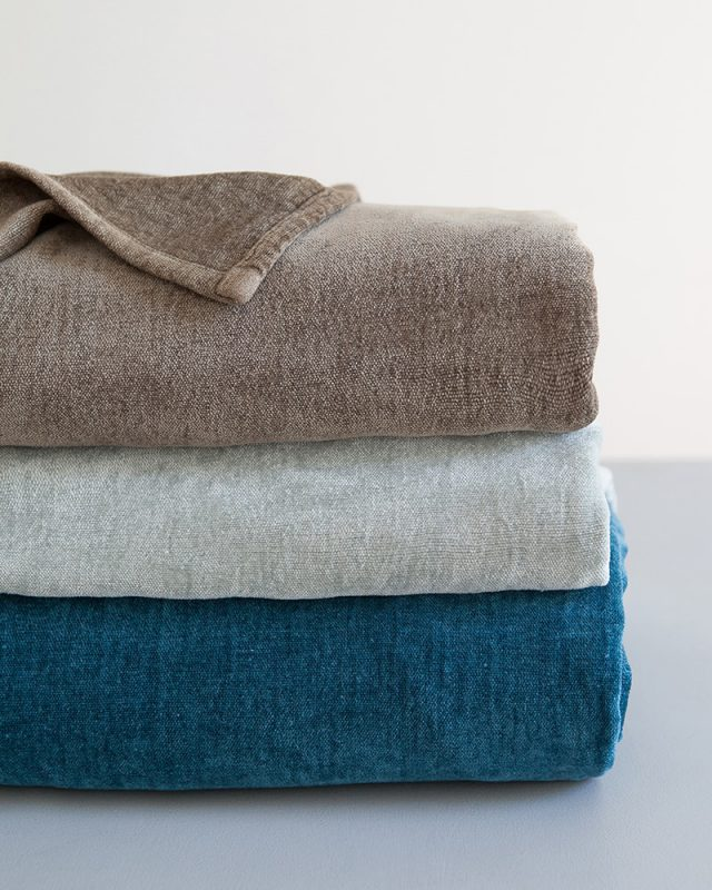 Mungo Deco Plain Weave Cotton And Viscose Chenille throws in Turquoise, Kelp and Pebble Stone. Textiles woven with all natural fibres at our mill in Plettenberg Bay, South Africa.