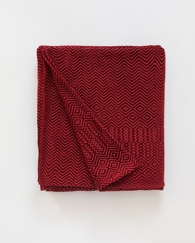 Mungo Kuba Zig Zag Cotton And Viscose Chenille Throw in Original Red.