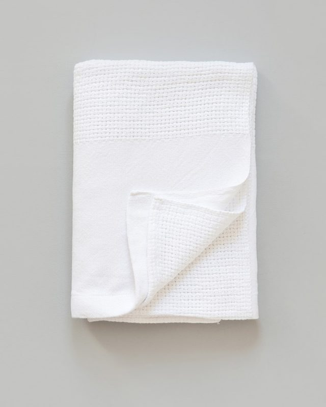 Mungo Organic Cotton Cellular Baby Blanket. Light, breathable and warm for baby. Woven in Plettenberg Bay at the Mungo Mill. White colourway