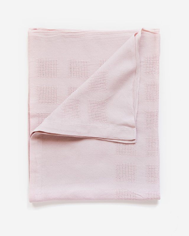 Mungo Organic Cotton Cot Baby Blanket in Pink. Textile woven from all natural fibres at our mill in Plettenberg Bay, South Africa.