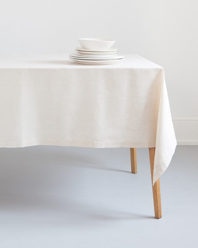 Mungo Kinsail Linen Table Cloth in Natural paired with white crockery for a crisp table setting.