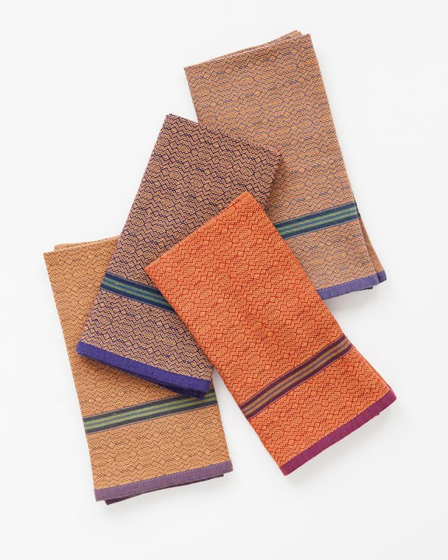 The Mungo boma cloth napkin is available in wide variety of colours - these in orange rust, orange stone, orange indigo and orange sand. Find the one to suit your home.