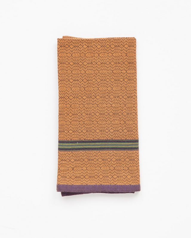 The Mungo boma cloth napkin is available in wide variety of colours - this one in orange indigo. Find the one to suit your home.