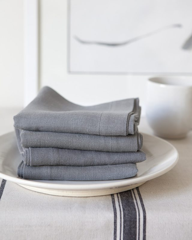 Mungo fumo grey pure linen serviettes paired with the Lisburn Linen runner in French Navy for the perfect minimalist table setting, quality table linen woven at the Mungo Mill in Plettenberg Bay