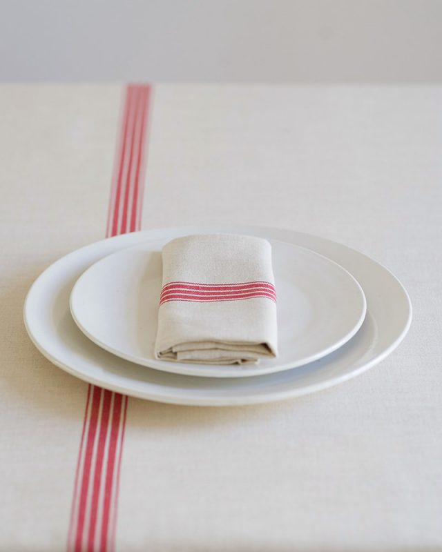 The Provincial strip table linen set includes a tablecoth and napkins and is pictures here with a res stripe, inspired by antique french grain sacking material and perfect for a country cottage look and feel