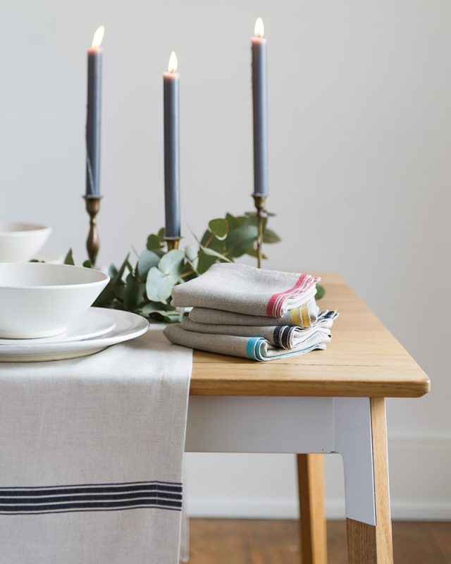 Table setting inspiration, pair the simple provincial stripe tablecloth with the selvedge napkins to add a pop of colour to you table, natural fibre table linen woven at the mungo mill in plettenberg bay