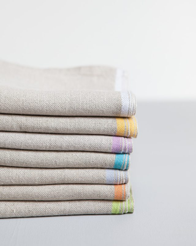 Stack of Folded Mungo pure linen Selvedge Napkin with colourful stripes that runs down the true selvedge, individually woven of our antique Ruti looms at the Mungo Mill in Plettenberg Bay