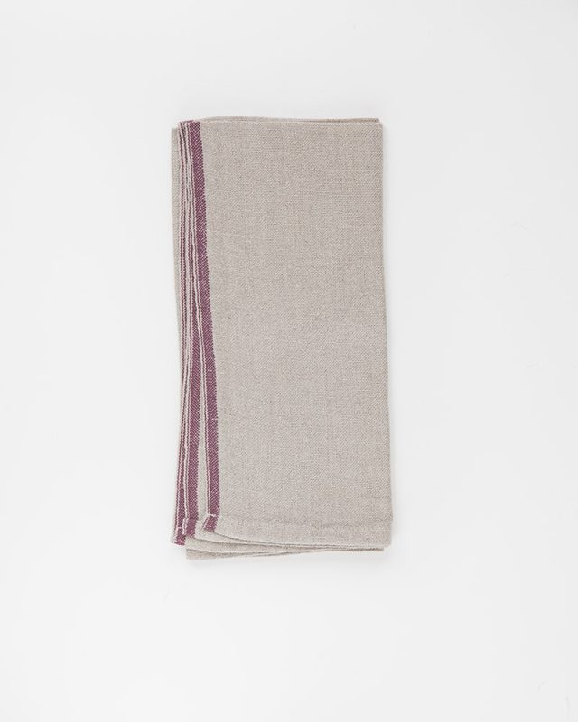 Mungo Natural Flax selvedge napkin with a burgendy stripe that runs down the true selvedge, individually woven of our antique Ruti looms at the Mungo Mill in  Plettenberg Bay