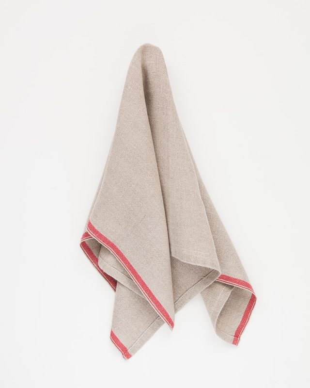 Mungo Natural Flax selvedge napkin with a red stripe that runs down the true selvedge, woven of our antique looms in plettenberg bay