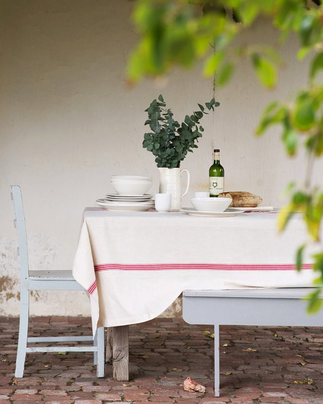 El fresco country table set with a Mungo Linen Provincial Stripe Table Cloth in Red.