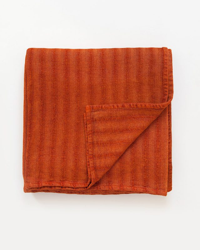 Mungo Undulating Herringbone Cotton And Viscose Chenille Throw in Namib Orange.