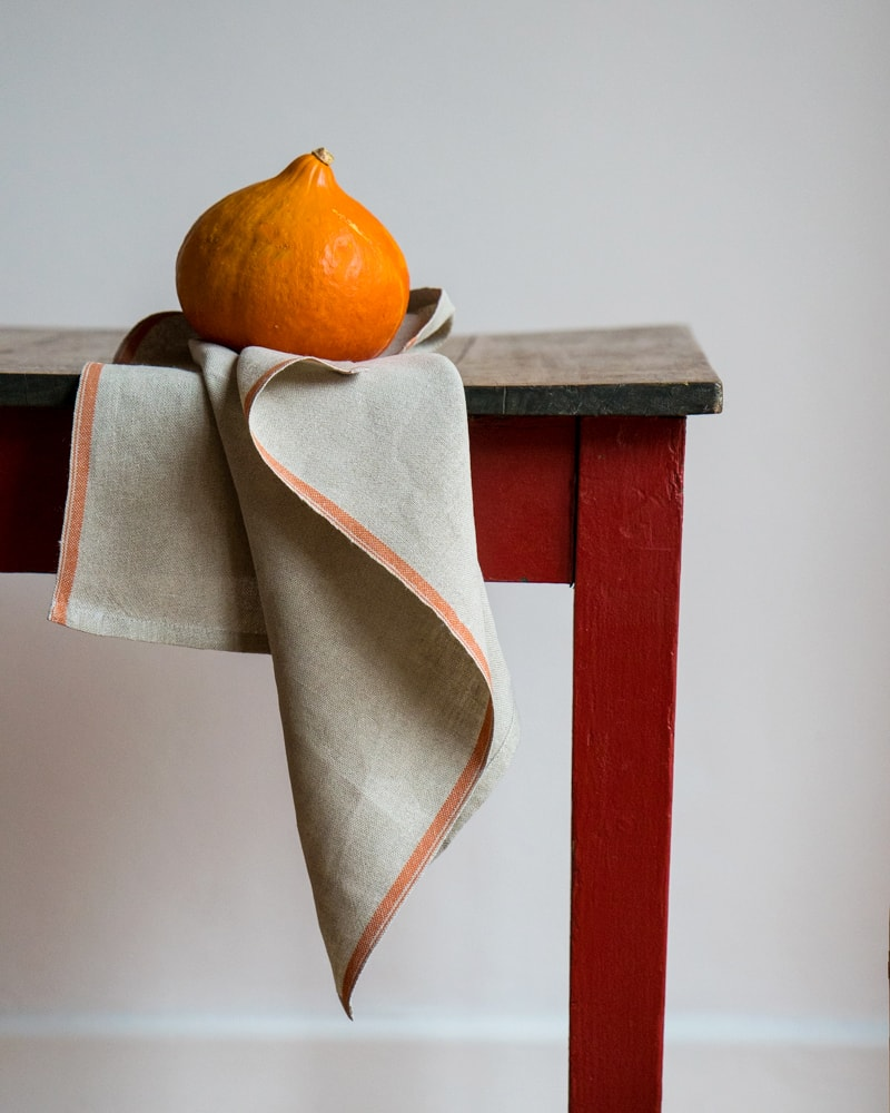 Flax Selvedge Napkins with a Pumpkin stripe that runs along the true selvedge, woven at the Mungo Mill on antique Ruti looms