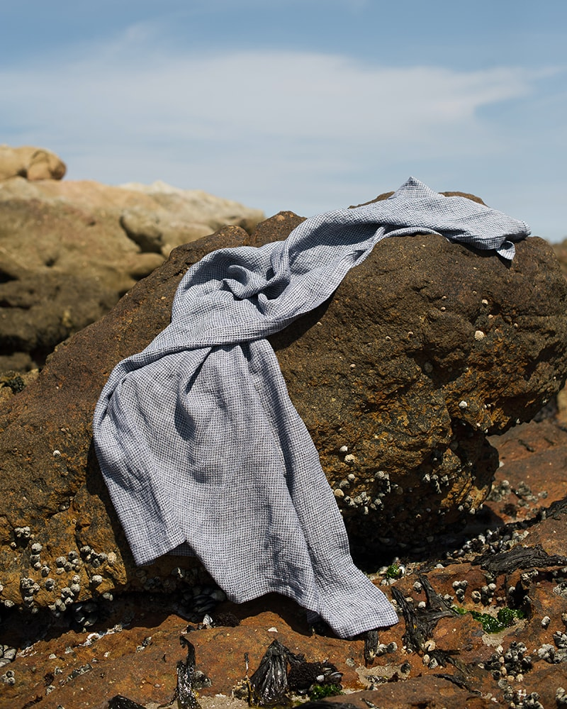 The Mungo Dhow towel woven with block weave is the perfect towel to take to the beach. Here is is pictures on the rock in Plettenberg Bay.