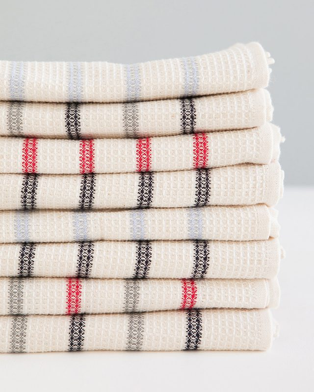 Mungo Linen and Cotton Waffle Weave Kitchen Towels in Lavender, Red, Black and Grey Stripe, folded and stacked. Made with all natural fibres on the looms at our mill in Plettenberg Bay.