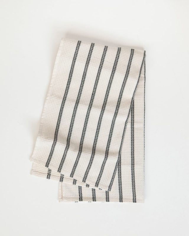 Mungo Linen and Cotton Waffle Weave Kitchen Towel in Black Stripe, folded. Made with all natural fibres on the looms at our mill in Plettenberg Bay.