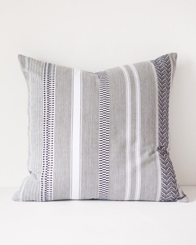The rolled grey Mungo Mali Cloth cushion cover woven at our mill in Plettenberg Bay