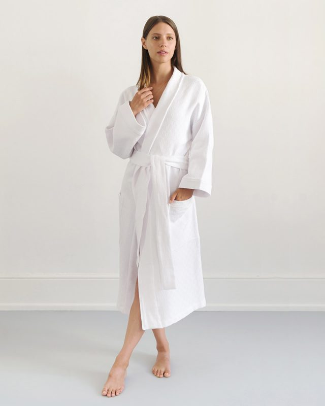 Woman posing in an all natural fibre Mungo Kamma Cotton Gown in textural White Willow weave