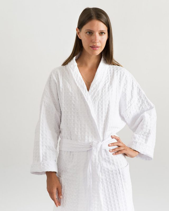 Woman posing in an all natural fibre Mungo Kamma Cotton Gown in textural White Lattice weave