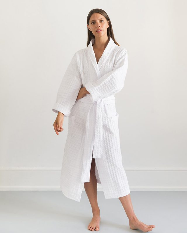 Woman wearing an all natural fibre Mungo Kamma Cotton Gown in textural White Lattice weave