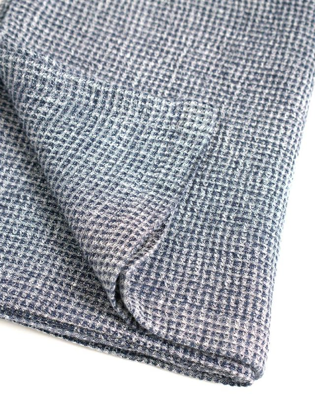 Mungo Dhow Towel in Deep Sea colourway. A 100% linen towel designed, made and woven at the Mungo Mill in Plettenberg Bay