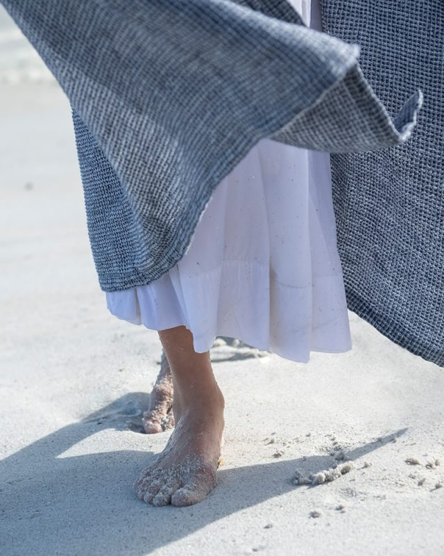 100% linen towel, the Mungo Dhow, in Sea Foam colourway. Pictured at Misty Cliffs beach in Cape Town