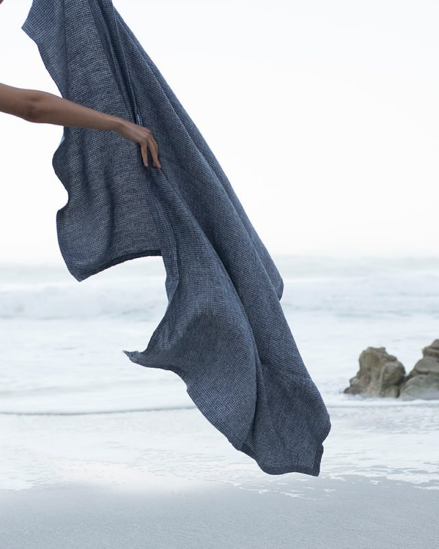 Mungo photoshoot at Misty Cliffs - the Dhow Towel in Deep Sea colourway