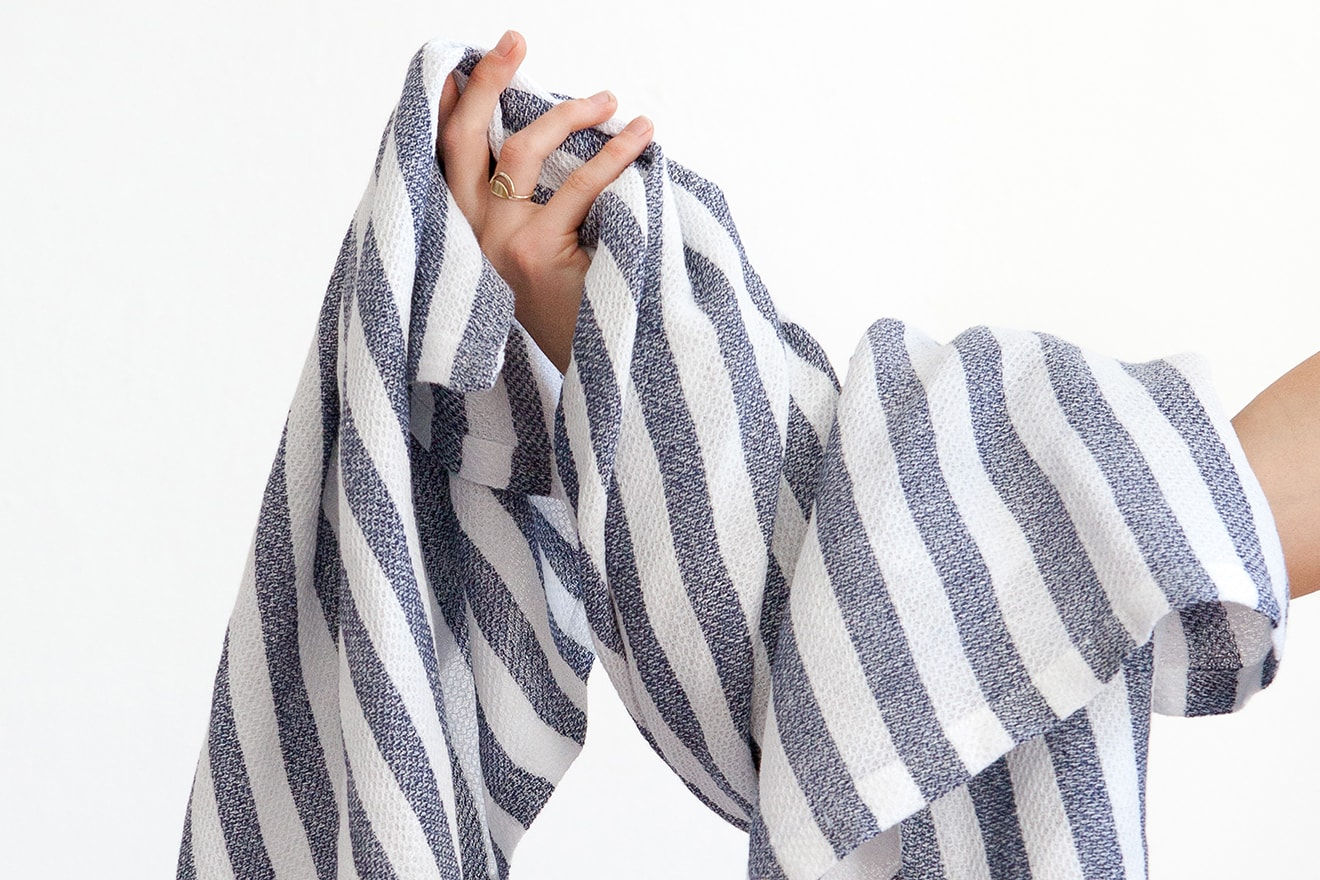 The Mungo Dhow Towel with classic stripes is woven from 100% linen