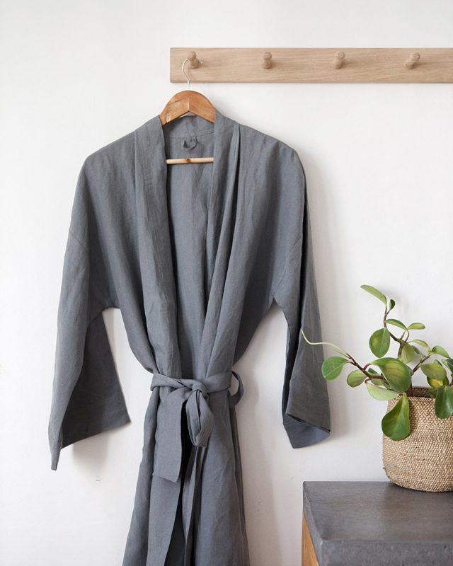 Mungo metal grey linen gown hanging in bathroom