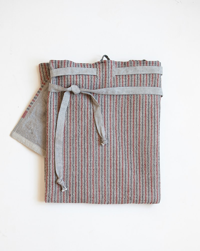 Many Red Mungo Man Cloth, a striped wrap-around apron for men