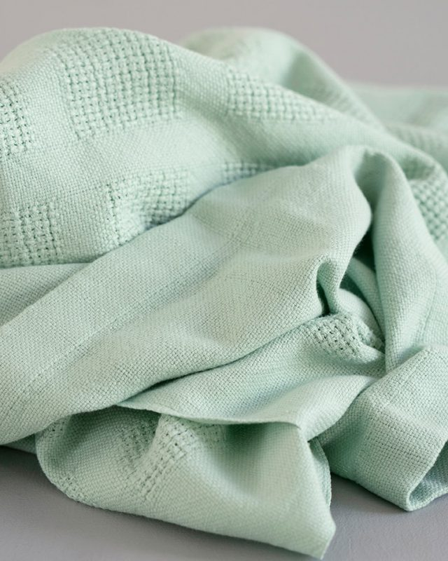 Organic cot blanket by Mungo woven in South Africa
