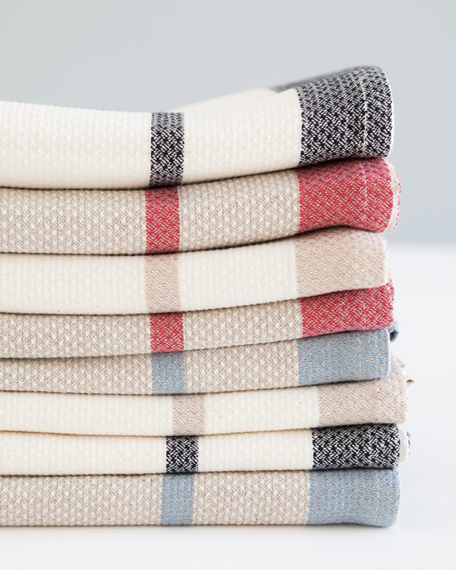 Mungo Huck Linen Kitchen Towels showing weave detail, stacked and folded.  Made with all natural fibres at our mill in Plettenberg Bay.