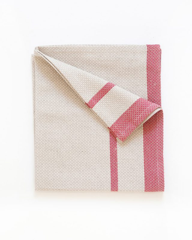 The Mungo Huck Linen Kitchen Towel in Red on Natural, folded in a square. Made with all natural fibres at our mill in Plettenberg Bay.