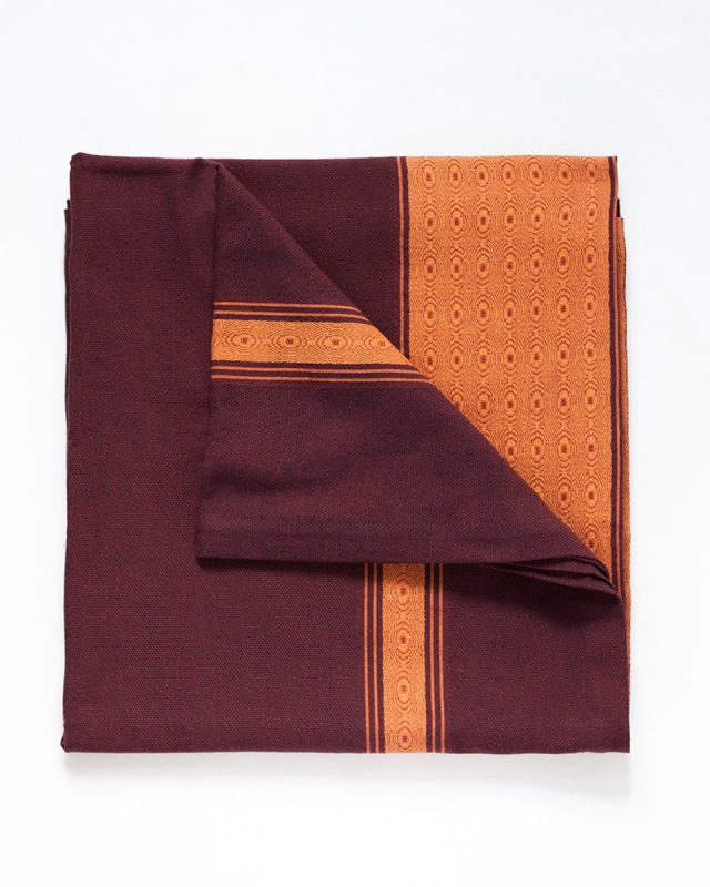 The Mungo Sunset Ottertrail tablecloth showing African detail weave