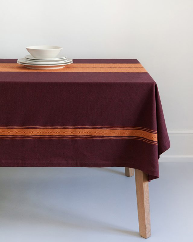 Mungo sunset Ottertrail tablecloth on table showing size
