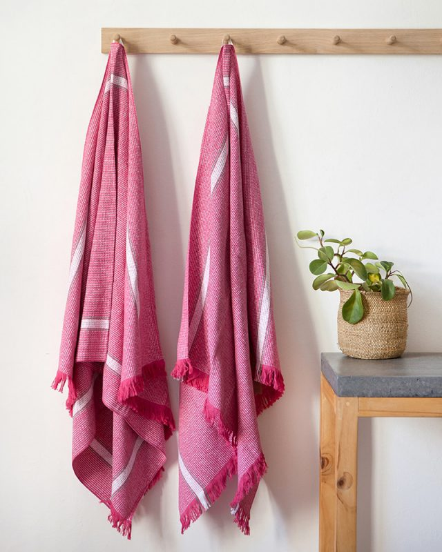 Hot Pink Summer towel with sewn in hanging loop, woven at the Mungo Mil on antique Lancashire Looms