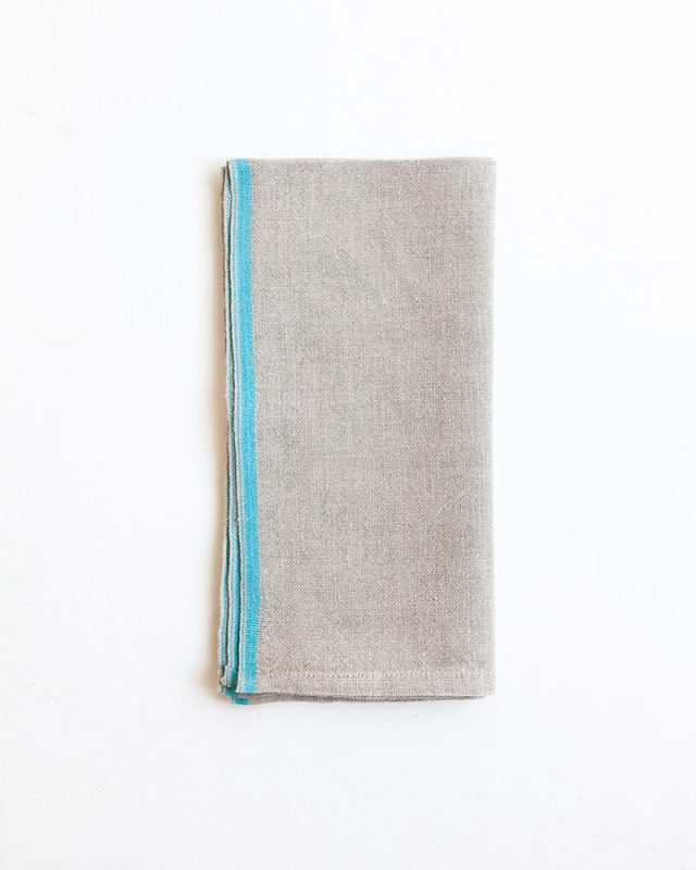 Mungo Selvedge Napkins woven from pure linen with a turquoise stripe