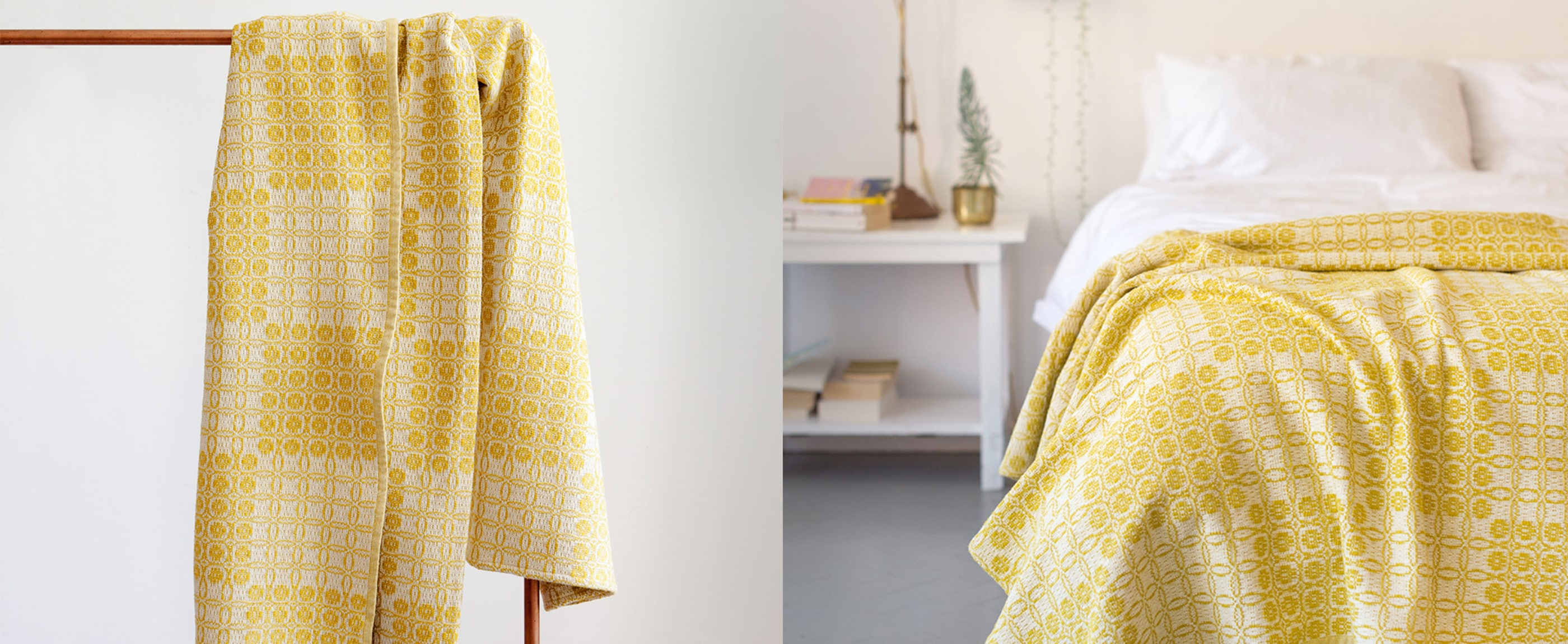The mustard Mungo Juno blanket used as a bed throw