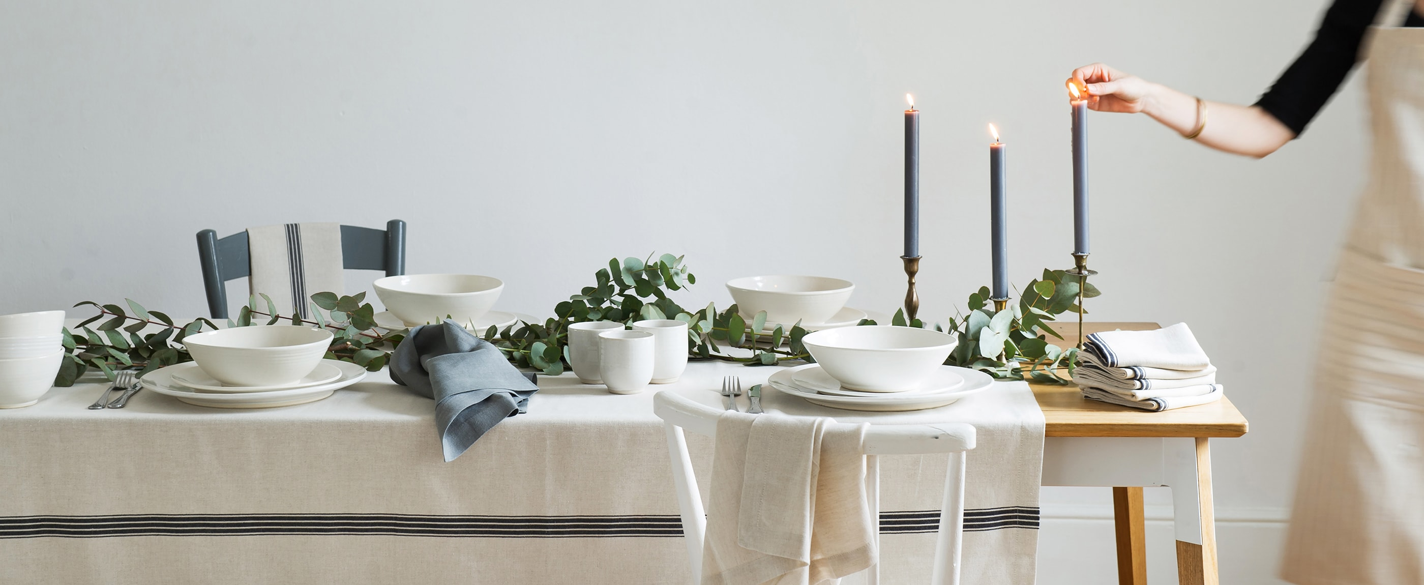 A Mungo table setting featuring our continental stripe table cloth