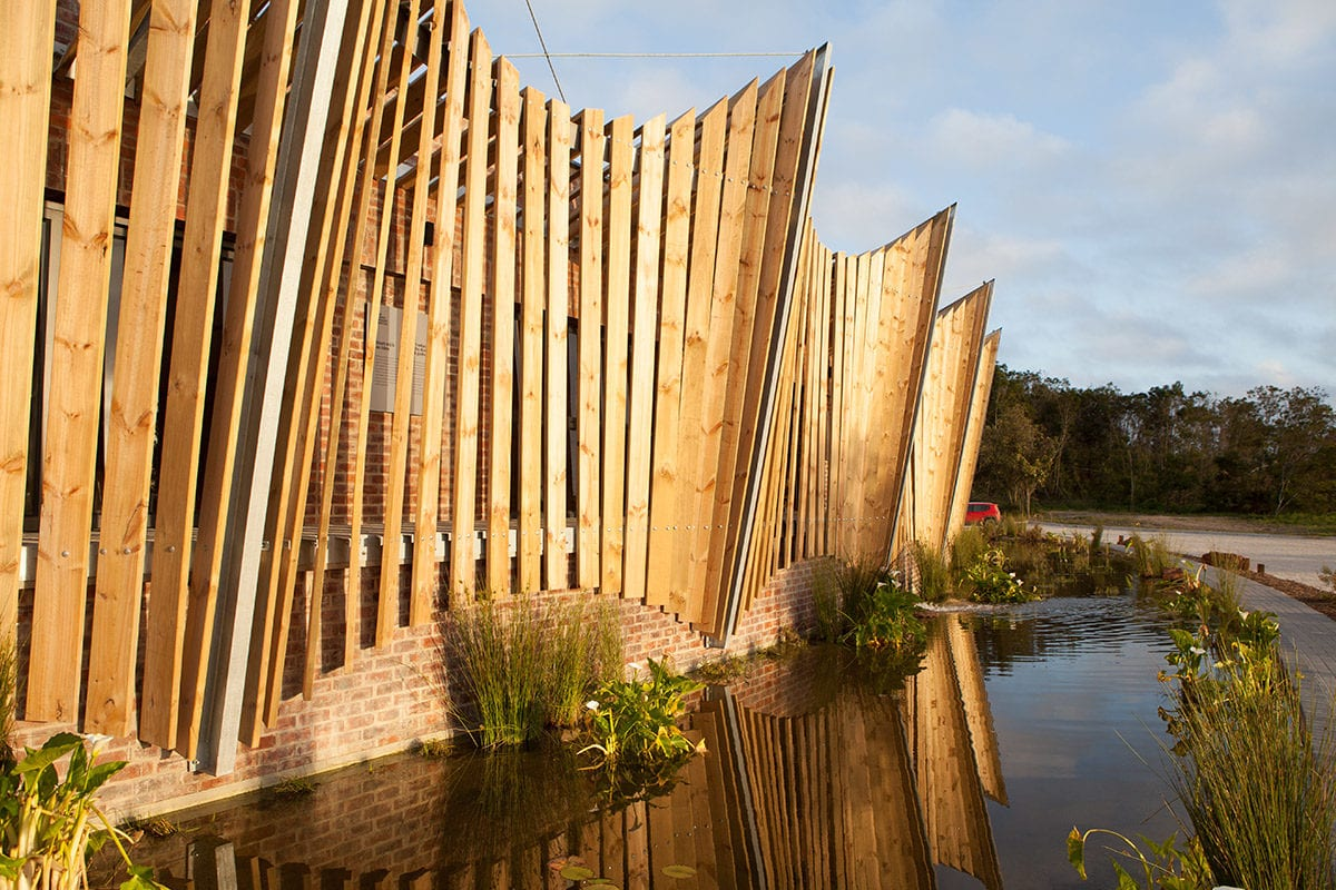 The exterior skin of the Mungo mill in Plettenberg Bay reflected in the mill pond.