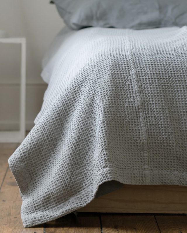 Mungo Cobble Weave bed cover in minimalist bedroom scene