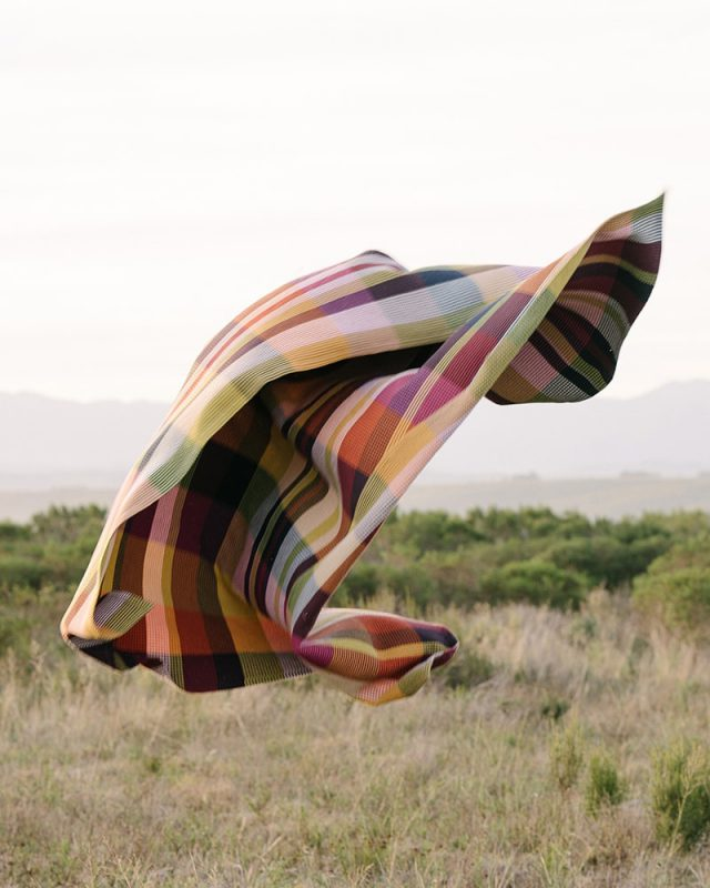 The Mungo Vrou-Vrou blanket in magenta in Plettenberg Bay mountains
