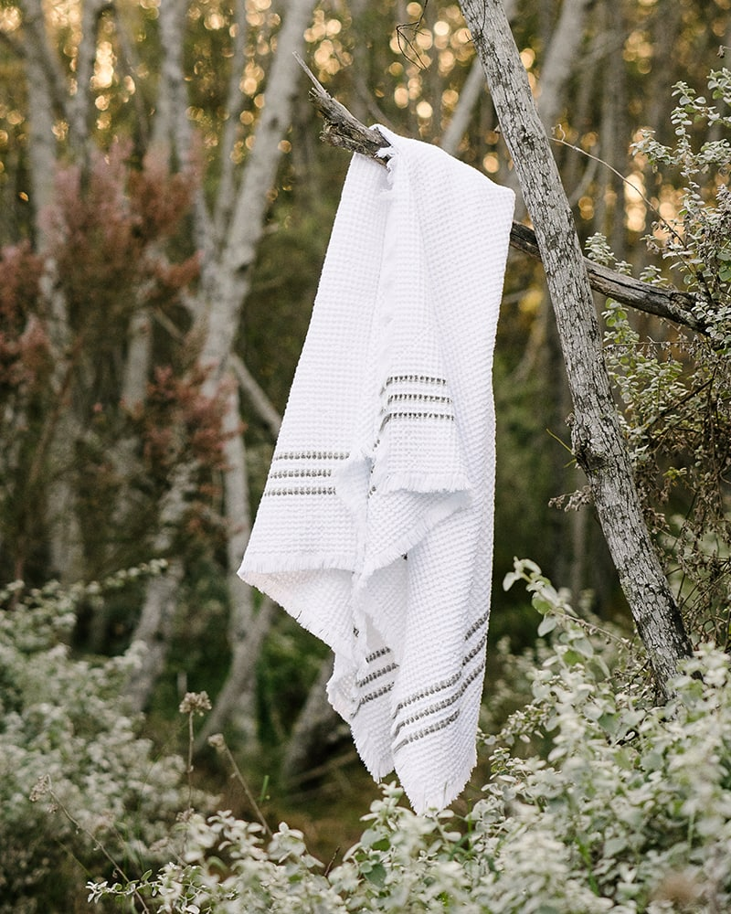 The Mungo Belgian Waffle Towel in charcoal hanging in Plettenberg Bay Forest