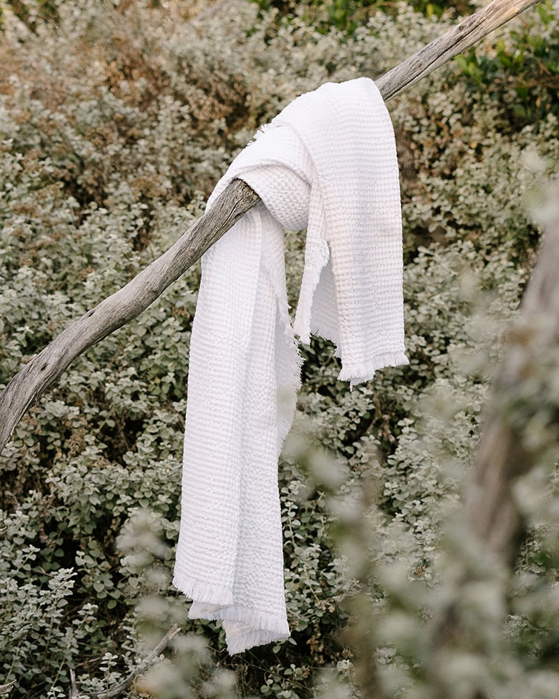 The Mungo Belgian Waffle Towel in white hanging in Plettenberg Bay Forest