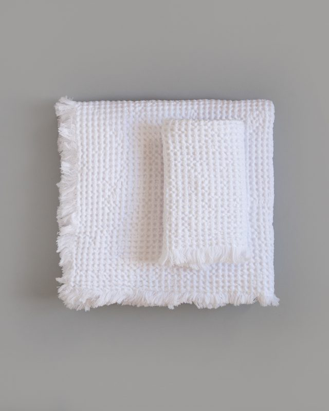 The Mungo Belgian Waffle Towel in white woven at our transparent mill in Plettenberg Bay