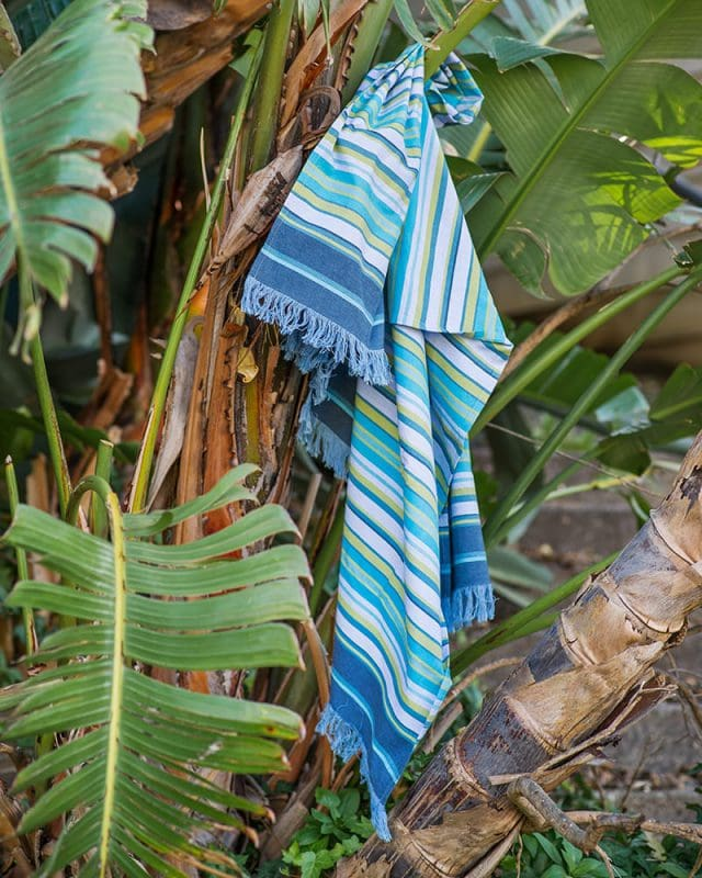 The Mungo 100% Cotton Kikoy South can be used as a versatile beach wrap or sarong for tropical beach holidays